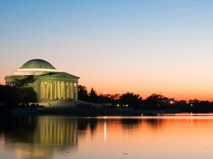 Jefferson Memorial, Washington DC. Evening background with warm gold, pink and blue tones.